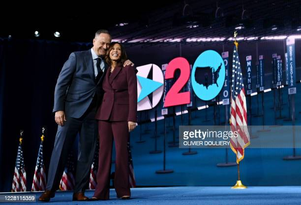 Senator from California and Democratic vice presidential nominee Kamala Harris and her husband Douglas Emhoff stand on stage at the end of the third...