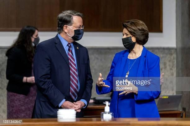 Senator Gary Peters, a Democrat from Michigan, left, speaks with Senator Amy Klobuchar, a Democrat from Minnesota, before the start of a Senate...
