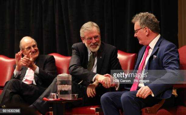 Senator George Mitchell looks on as Gerry Adams shakes Mike Nesbitts hand at a Good Friday Agreement 20th anniversary event at the Library of...