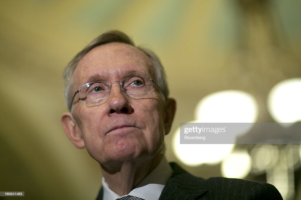 Senator Harry Reid, a Democrat from Nevada, listens to a question during a news conference after the weekly Democratic Policy Committee meeting in Washington, D.C., U.S., on Tuesday, Jan. 29, 2013. President Barack Obama sought to build on gathering political momentum for sweeping revisions to the nation's immigration laws, giving cautious endorsement to a new Senate blueprint and offering more details of his own plan. Photographer: Andrew Harrer/Bloomberg via Getty Images