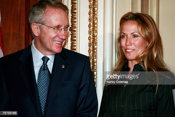 Senator Harry Reid and Sheryl Crow listen to speakers at the National Breast Cancer Coalition press conference at The Capitol on March 28 2007 in...