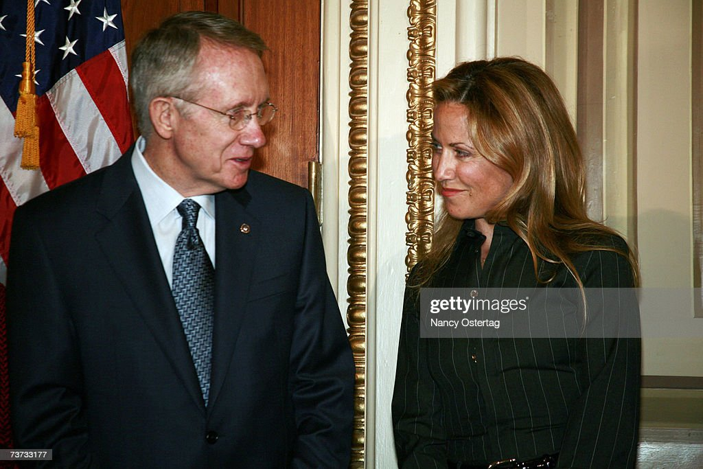Senator Harry Reid (D-NV) shares a moment with breast cancer survivor Sheryl Crow at the National Breast Cancer Coalition press conference at The Capitol on March 28, 2007 in Washington, DC.