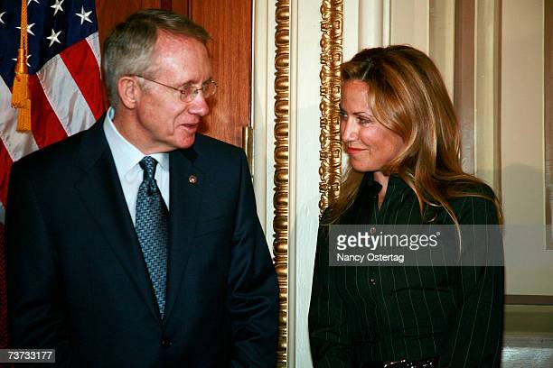 Senator Harry Reid shares a moment with breast cancer survivor Sheryl Crow at the National Breast Cancer Coalition press conference at The Capitol on...