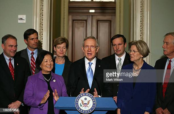 Senator Harry Reid stands with incoming freshman members of the Senate Democratic Caucus on November 14 2012 in Washington DC He was joined by Tim...