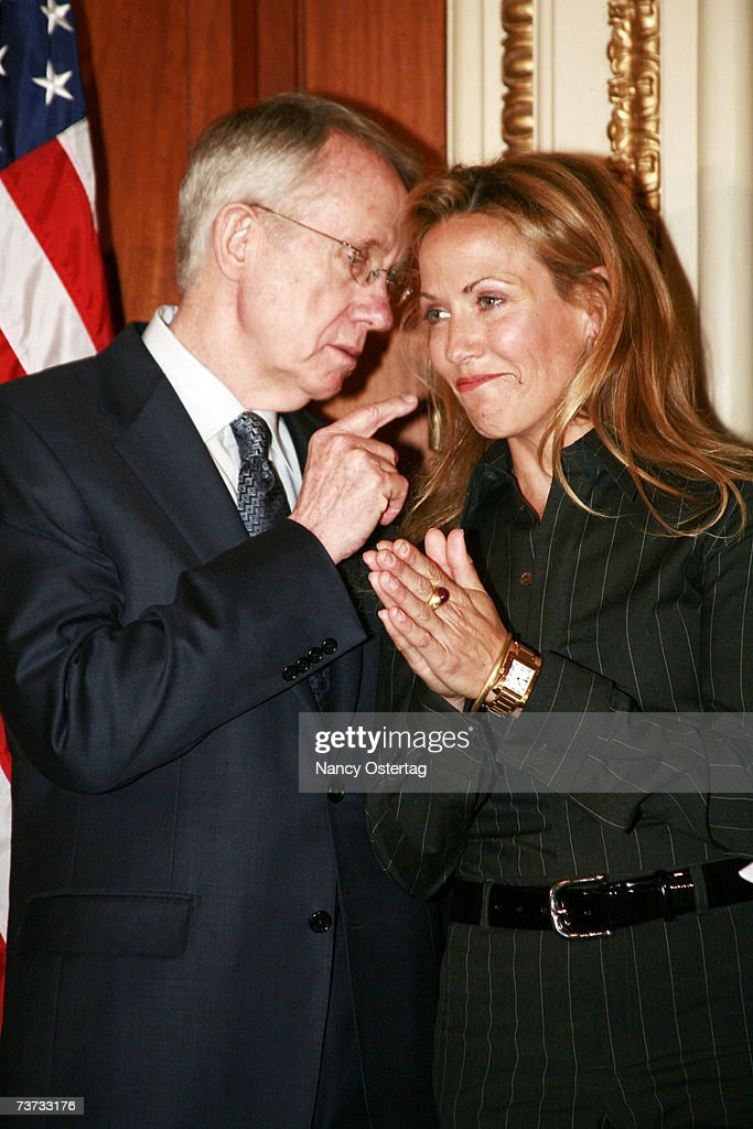 Senator Harry Reid (D-NV) talks to breast cancer survivor Sheryl Crow at the National Breast Cancer Coalition press conference at The Capitol on March 28, 2007 in Washington, DC.