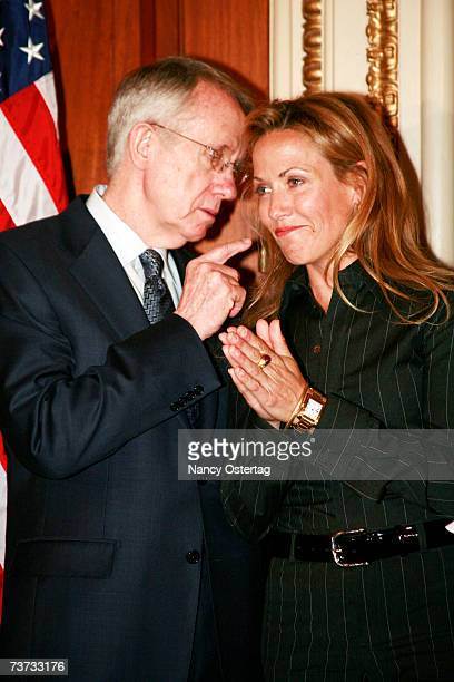 Senator Harry Reid talks to breast cancer survivor Sheryl Crow at the National Breast Cancer Coalition press conference at The Capitol on March 28...