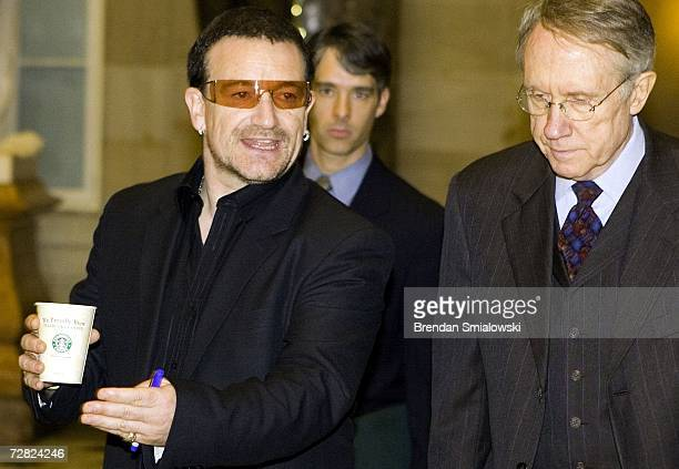 S Senator Harry Reid walks with singer Bono on Capitol Hill December 14 2006 in Washington DC Bono's visit to the hill came as Democratic control of...