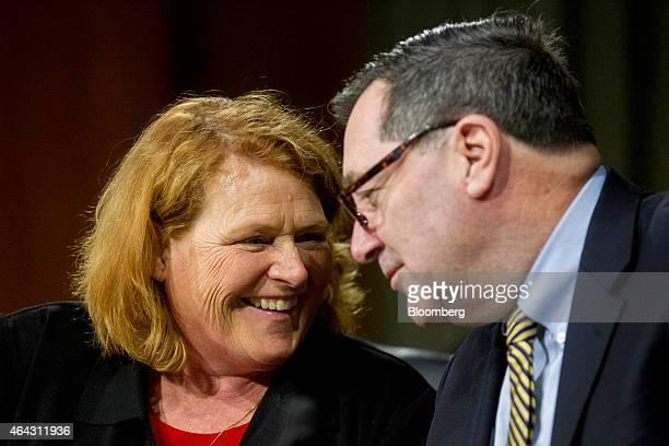 Senator Heidi Heitkamp a Democrat from North Dakota left talks to Senator Joe Donnelly a Democrat from Indiana during a Senate Banking Committee...