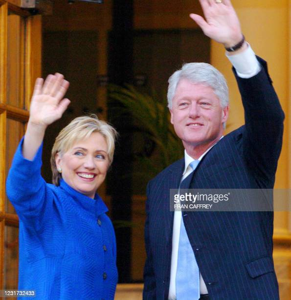 Senator Hillary Clinton and Former US President Bill Clinton wave to well wishers as they arrive for a meeting with Irish Prime Minsiter Bertie Ahern...