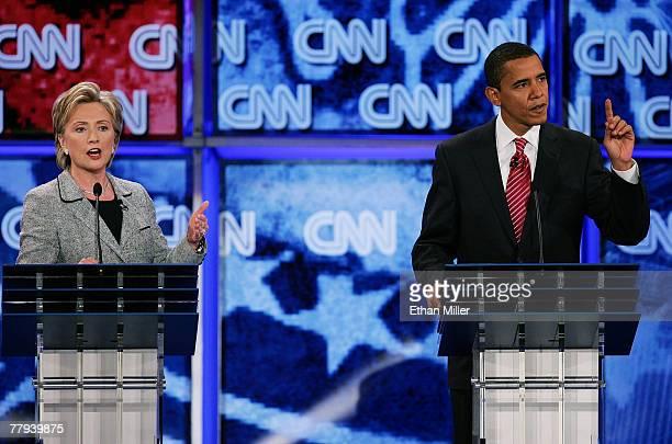 S Senator Hillary Clinton and US Senator Barack Obama speak during a Democratic presidential debate at UNLV sponsored by CNN November 15 2007 in Las...
