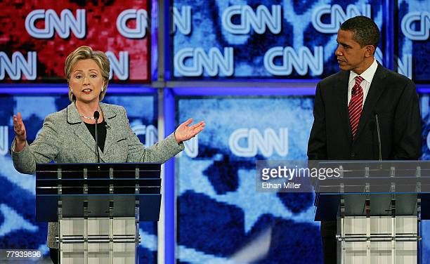 S Senator Hillary Clinton and US Senator Barack Obama speak during a Democratic presidential debate at UNLV sponsored by CNN November 15 2007 in Las...