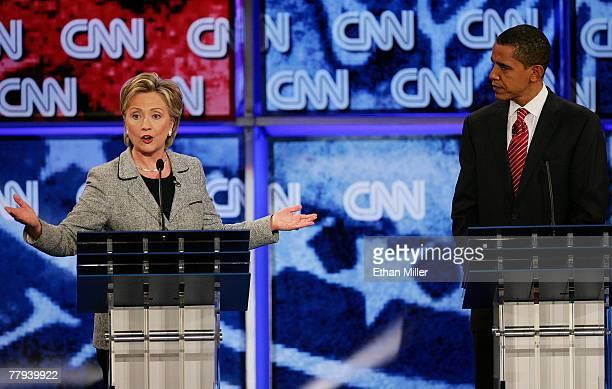 Senator Hillary Clinton and U.S. Senator Barack Obama speak during a Democratic presidential debate at UNLV sponsored by CNN November 15, 2007 in Las...