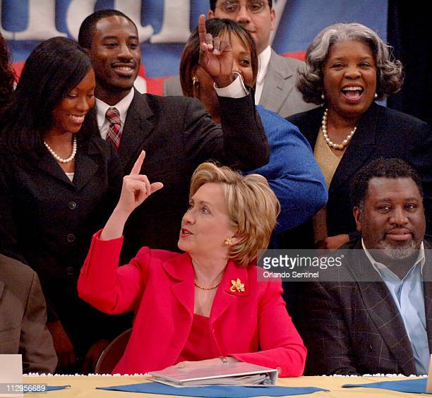 US Senator Hillary Clinton jokes with members of a roundtable discussion panel after discussing subprime mortgages at the Englewood Neighborhood...