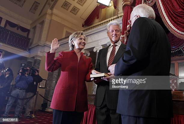 Senator Hillary Clinton poses for a photo during a ceremonial swearing in at the Old Senate Chamber at the US Capitol in Washington DC Thursday...