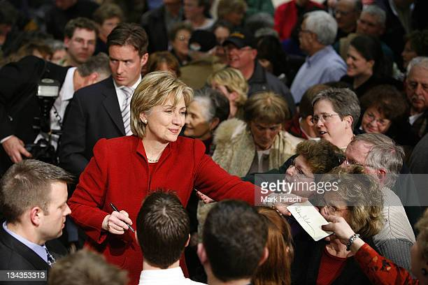 Senator Hillary Clinton signs autographs following a campaign stop at the University of Dubuque Myers Teaching and Administrative Center on Sunday...