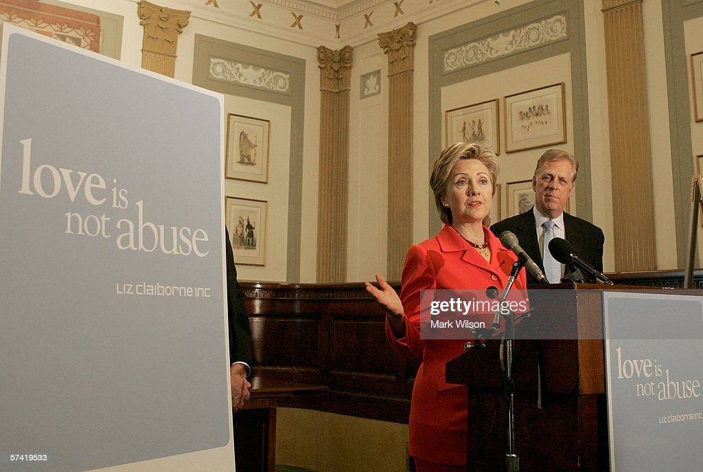 U.S. Senator Hillary Clinton (D-NY) speaks while flanked by Liz Claiborne Chairman Paul R. Charron (R) during a news conference on Capitol Hill April 25, 2006 in Washington DC. The news conference was held to announce the results of a new survey conducted by Teenage Research Unlimited that shows a significant number of teens are abusing each other in their dating relationships.