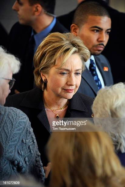 1/4/2008 Senator Hillary Clinton speaks with a woman who asked her about heath care after the rally at the Nashua Airport where hundreds of...