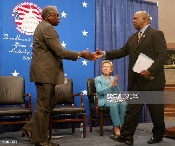 S Senator Hillary Clinton watches as Rep Elijah E Cummings and Rep James E Clyburn shake hands during an event on Capitol Hill July 15 2004 in...