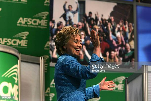 Senator Hillary Rodham Clinton a Democrat from New York acknowledges applause before speaking at a presidential candidates forum at the Leadership...