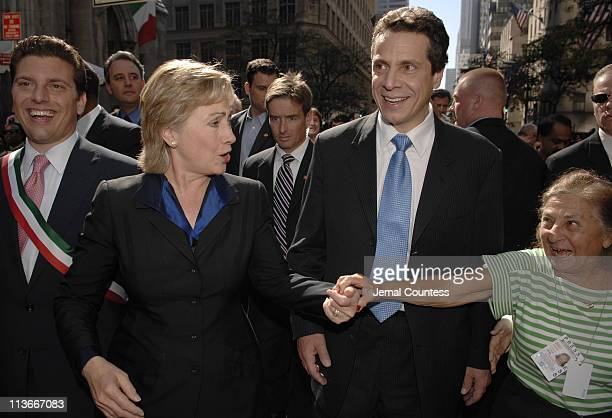 Senator Hillary Rodham Clinton and Andrew Cuomo greet a supporter at the 2006 Columbus Day parade in New York City October 9 2006