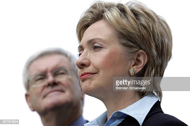 Senator Hillary Rodham Clinton and former House Speaker Newt Gingrich listen during a media conference on Capitol Hill May 11, 2005 in Washington,...