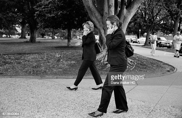 Senator Hillary Rodham Clinton and her deputy communications director, Sarah Gegenheimer, walk between the Capitol and her office in the Russell...