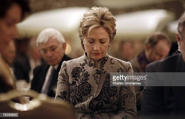 Senator Hillary Rodham Clinton bows her head in prayer during the National Prayer Breakfast on February 1 2007 in Washington DC