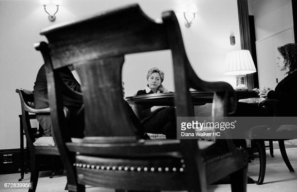 Senator Hillary Rodham Clinton chats with aides during an early morning meeting in her office in the Russell Senate Office Building on July 19, 2001...