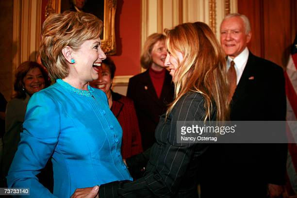 Senator Hillary Rodham Clinton greets Sheryl Crow at the National Breast Cancer Coalition press conference at The Capitol on March 28 2007 in...