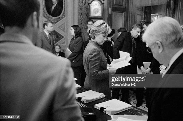 Senator Hillary Rodham Clinton is photographed in the President's Room off the Senate chamber marking up a bill with other members of the Armed...