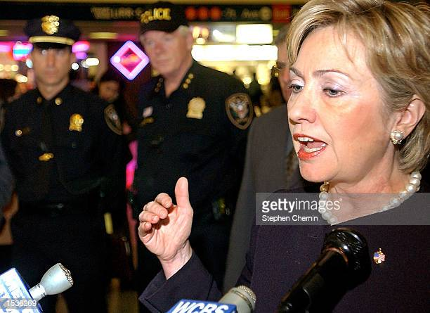 S Senator Hillary Rodham Clinton speaks during a media conference as two Amtrak policemen stand by October 28 2002 at Penn Station in New York City...