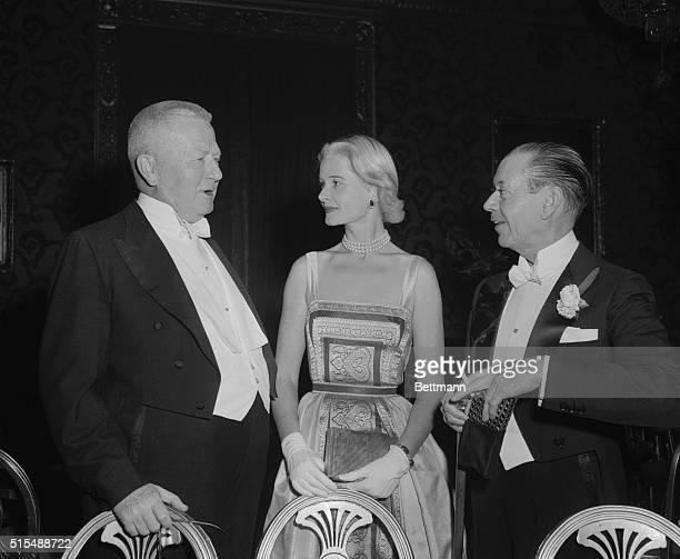 Senator James Duff Pennsylvania and composer Cole Porter talking to Mrs Winston guest at the seasonal premiere of Il Trovatore at the Metropolitan...