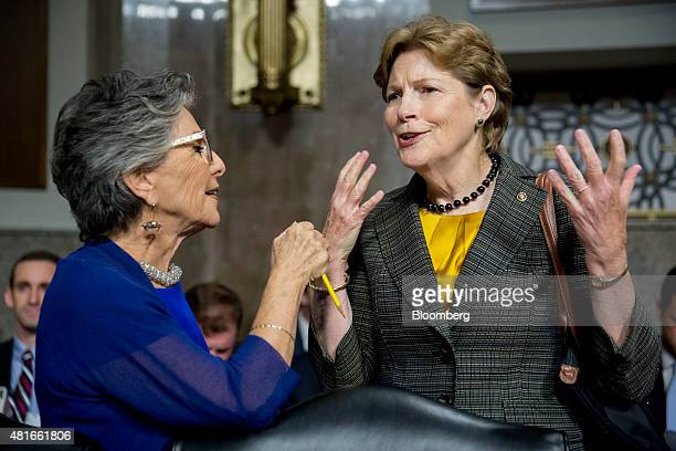 Senator Jeanne Shaheen a Democrat from New Hampshire right talks to Senator Barbara Boxer a Democrat from California before the start of a Senate...