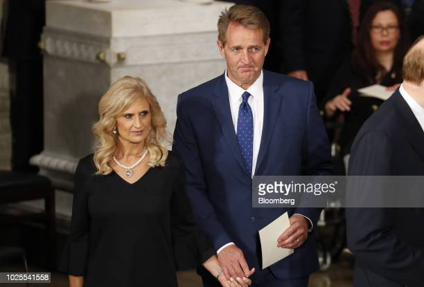 Senator Jeff Flake a Republican from Arizona and wife Cheryl Flake arrive for a memorial service for late Senator John McCain at the US Capitol...