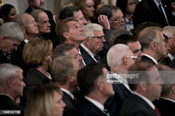 Senator Jeff Flake a Republican from Arizona looks up during a memorial service for former US President George HW Bush in Washington DC US on Monday...