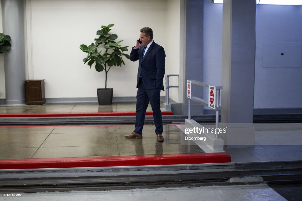 Senator Jeff Flake, a Republican from Arizona, speaks on a mobile device while waiting for the Senate Subway in the basement of the U.S. Capitol in Washington, D.C., U.S., on Wednesday, Feb. 14, 2018. A bipartisan Senate group tentatively agreed on a trimmed-down immigration proposal Wednesday that would allow citizenship for young undocumented immigrants and provide $25 billion for a border wall without meeting White House demands for cuts in family migration and eliminating a visa lottery. Photographer: Zach Gibson/Bloomberg via Getty Images