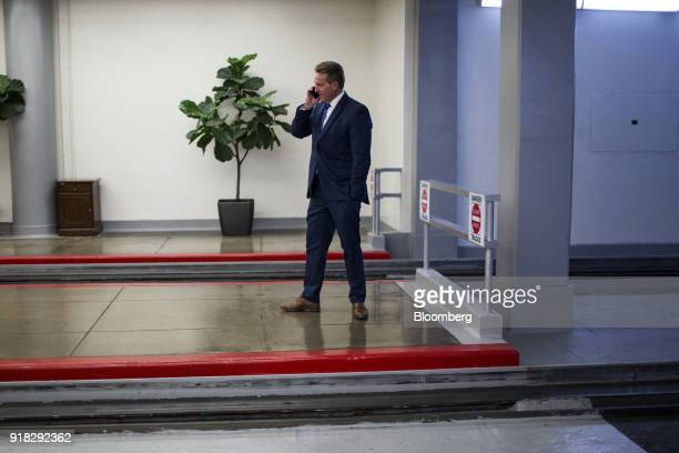 Senator Jeff Flake a Republican from Arizona speaks on a mobile device while waiting for the Senate Subway in the basement of the US Capitol in...