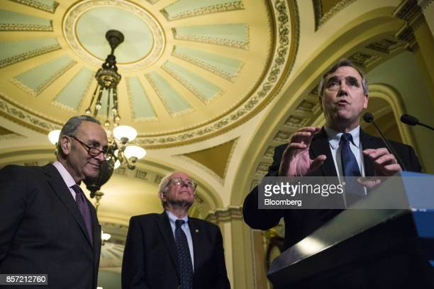 Senator Jeff Merkley a Democrat from Oregon right speaks while Senate Minority Leader Chuck Schumer a Democrat from New York left and Senator Bernie...