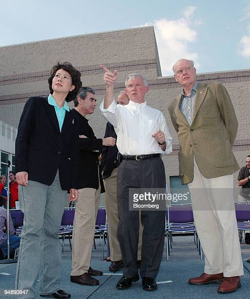 Senator Jeff Sessions center points out areas along the Alabama State Docks to US Department of Labor Secretary Elaine Chao far left and US...
