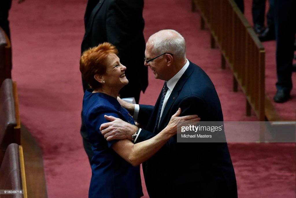 Senator Jim Molan is congratulated by Senator Pauline Hanson after delivering his first speech in the Senate on February 14, 2018 in Canberra, Australia.
