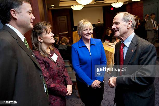 Senator Jim Risch and his wife Vicky, center, speak with Tadd Jenkins and his wife Tamra of Iowa Falls, Iowa, during a reception after Sen. Risch was...
