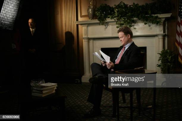 Senator Jim Webb reviews his notes as he works on the Democrats response to President George W Bush 's State of the Union address in Washington DC