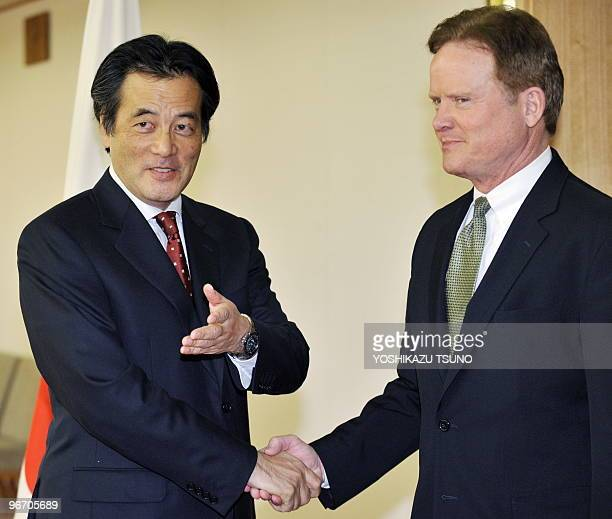 US Senator Jim Webb shakes hands with Japanese Foreign Minister Katsuya Okada prior to their talks at Okada's office in Tokyo on February 15 2010...