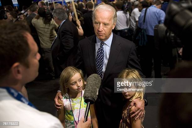 S Senator Joe Biden talks to the media with his granddaughters Finnegan Biden and Maisy Biden in the spin room after the ABC News Democratic...