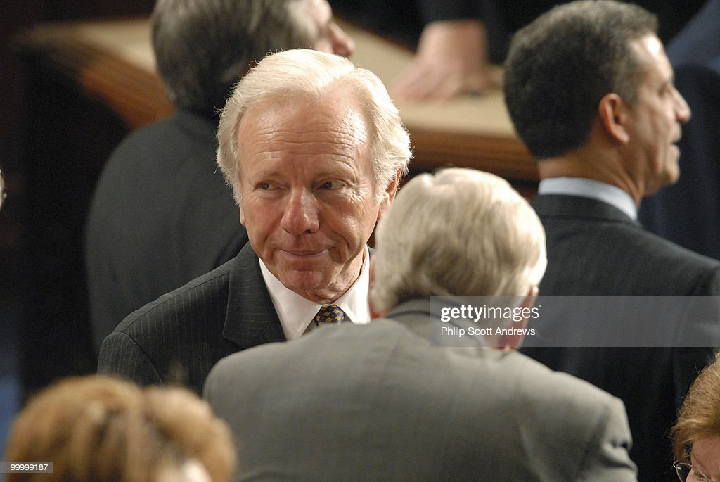 Senator Joe Lieberman, D-Conn talks with members on the house floor before Nuri al-Maliki, Prime Minister of Iraq, speaks to a joint session of Congress.