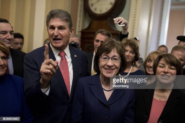 Senator Joe Manchin a Democrat from West Virginia center left and Senator Susan Collins a Republican from Maine center speak with members of the...