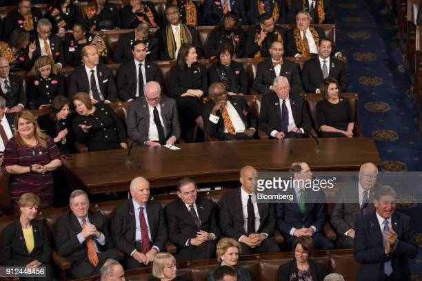 Senator Joe Manchin a Democrat from West Virginia stands and claps as his fellow democrats stay seated while US President Donald Trump not pictured...
