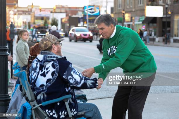 US Senator Joe Manchin greets people during the homecoming parade for Marshall University in Huntington West Virginia on October 18 2018 Manchin is a...