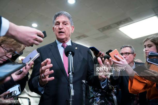 Senator Joe Manchin speaks to the press near the Senate subway following a vote in the Senate impeachment trial that acquitted President Donald Trump...