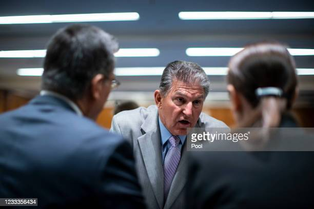 Senator Joe Manchin speaks with Xavier Becerra, Secretary of Health and Human Services , before a Senate Appropriations Subcommittee hearing on June...